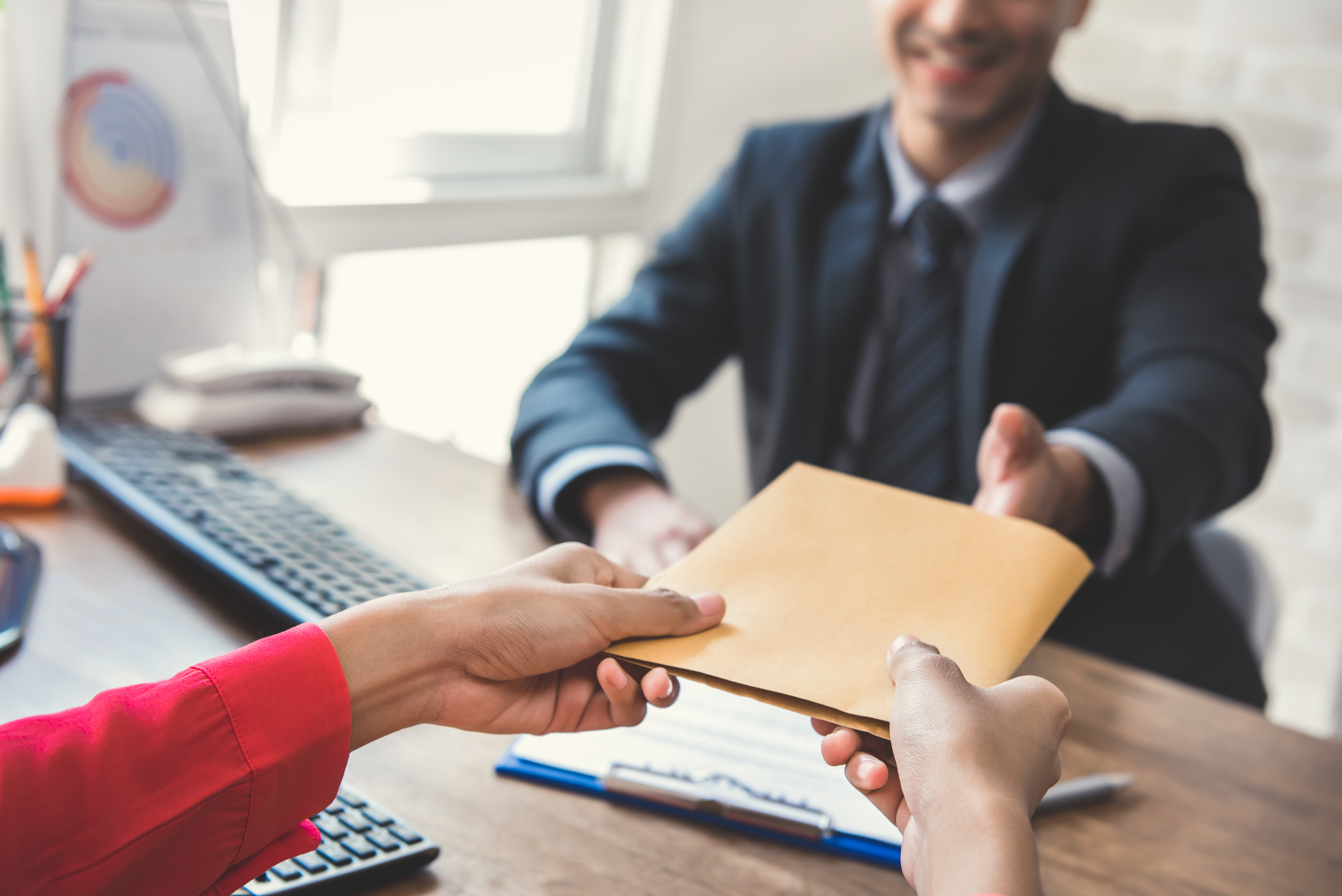Business man handing documents to woman. Judicial Research provides the Best in Litigation support with: Printing, E Paper Discovery, Document Scanning, Indexing, Mounting, Duplication, Labeling ...