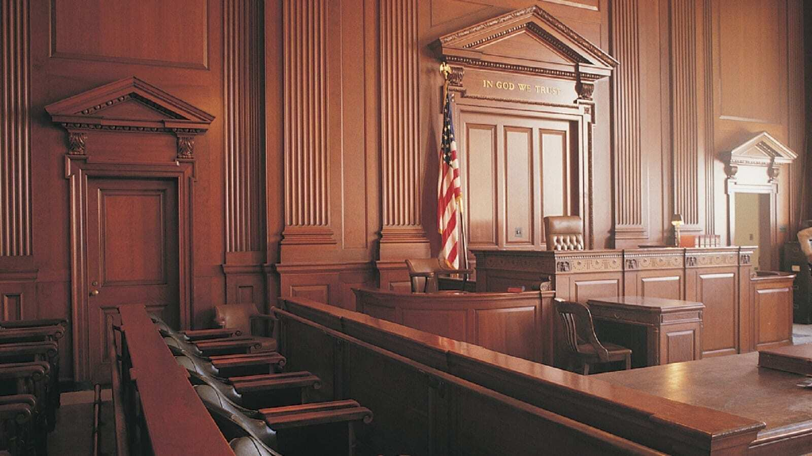 Brown interior of Court room. Count on Judicial Research for all your Court Services from Electronic to In Person Filing, Subpoenas, in Bankruptcy, Circuit, & Federal US District Courts