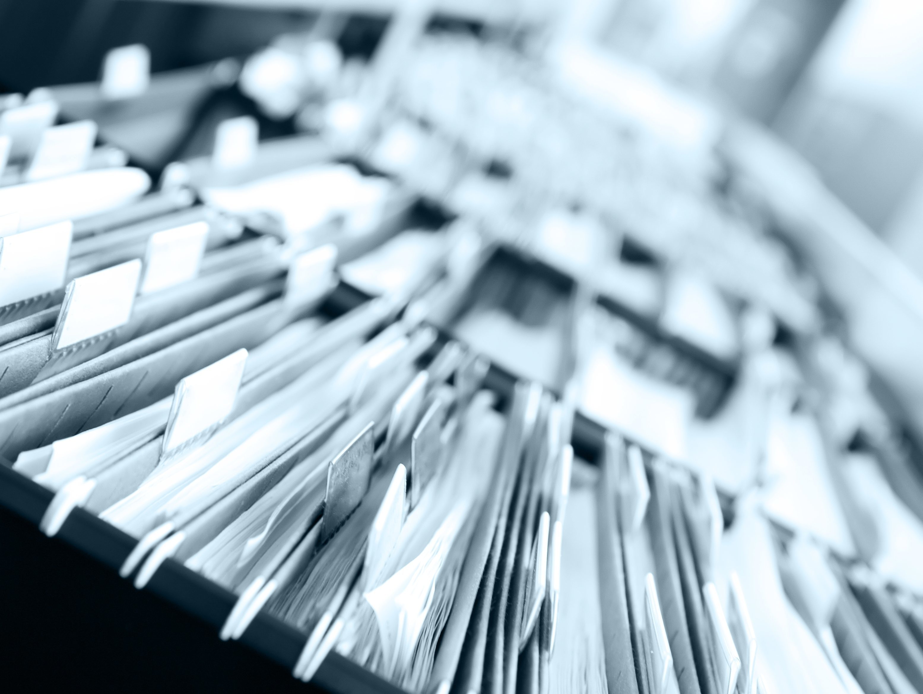 Documents indexed in a filing cabinet. Miami's Best Premier Litigation Support services in index, bates labeling, pagination with express services available. Easy, quick, and hassle free indexing